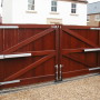 Wooden timber gate with piston gate motors