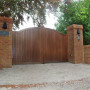 Close boarded wooden gates with Intercom